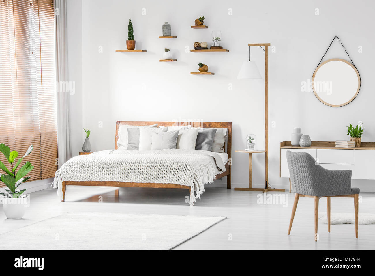 Front View Of A Bright Natural Bedroom Interior With Wooden