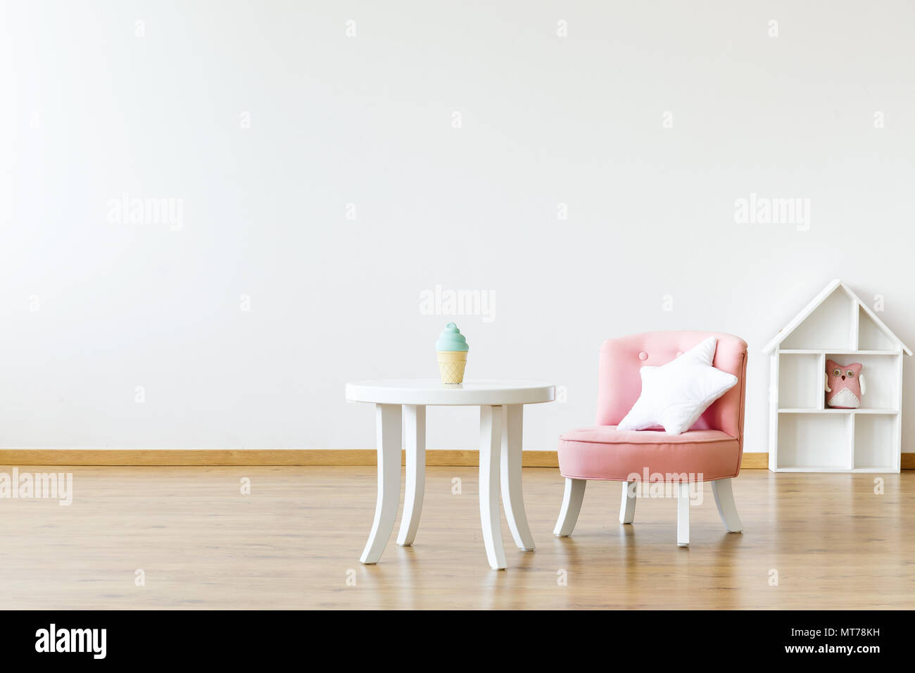 Kid S Table And Chair With A Star Pillow In A White Empty Room