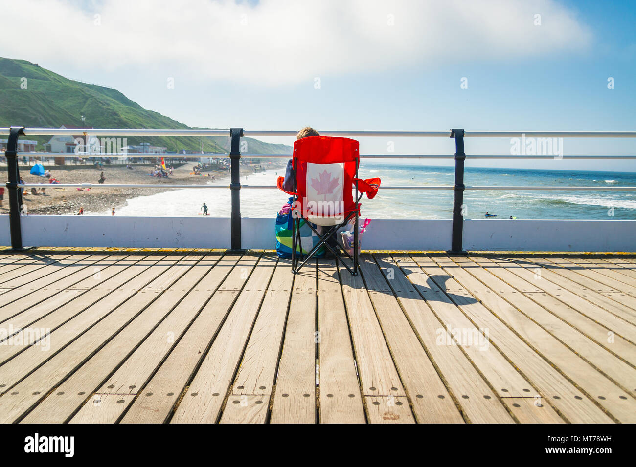Sitting on the pier wasting time - Stock Image