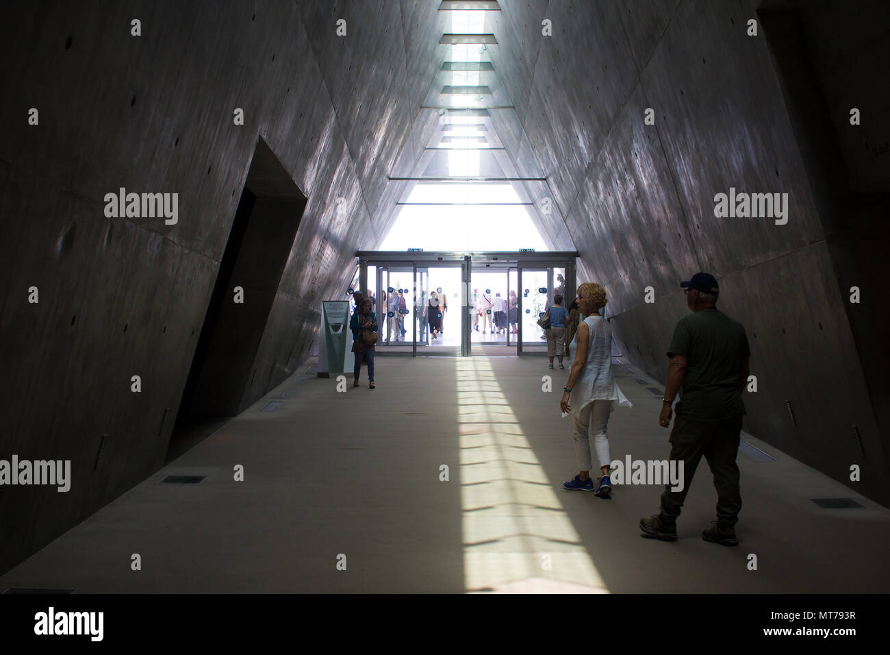9 May 2018 Visitors leaving the darkness of the Yad Vashem museum in Jerusalem Israel and moving into the bright light of day. - Stock Image