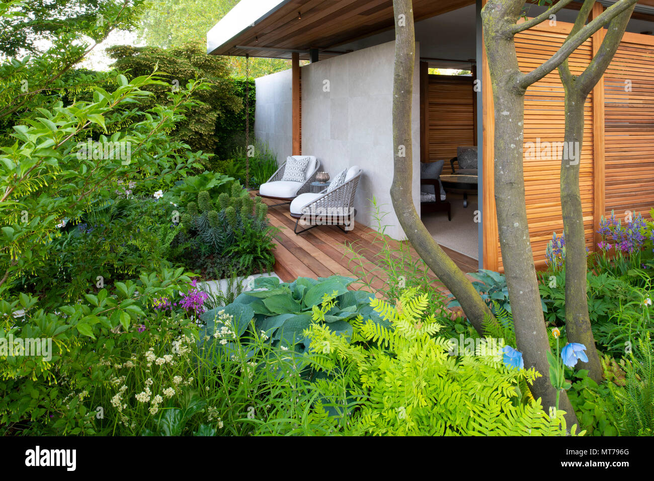 A wide variety of plants surrounding the pavilion in the Morgan Stanley Garden for the NSPCC designed by Chris Beardshaw and winner of the Best Show G - Stock Image