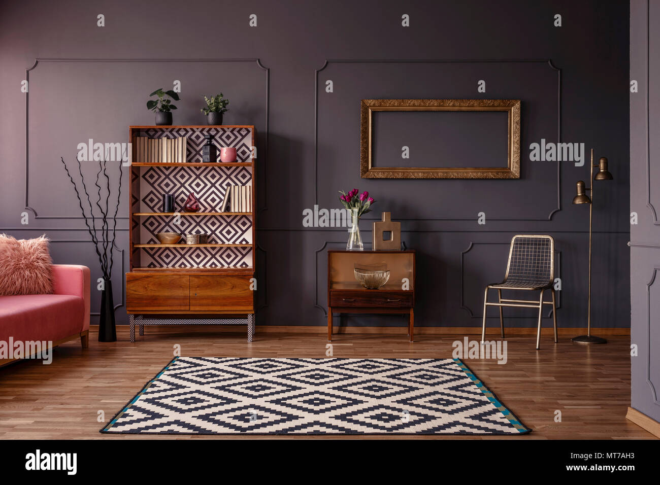 Vintage living room interior with a patterned rug, cupboard, golden ...