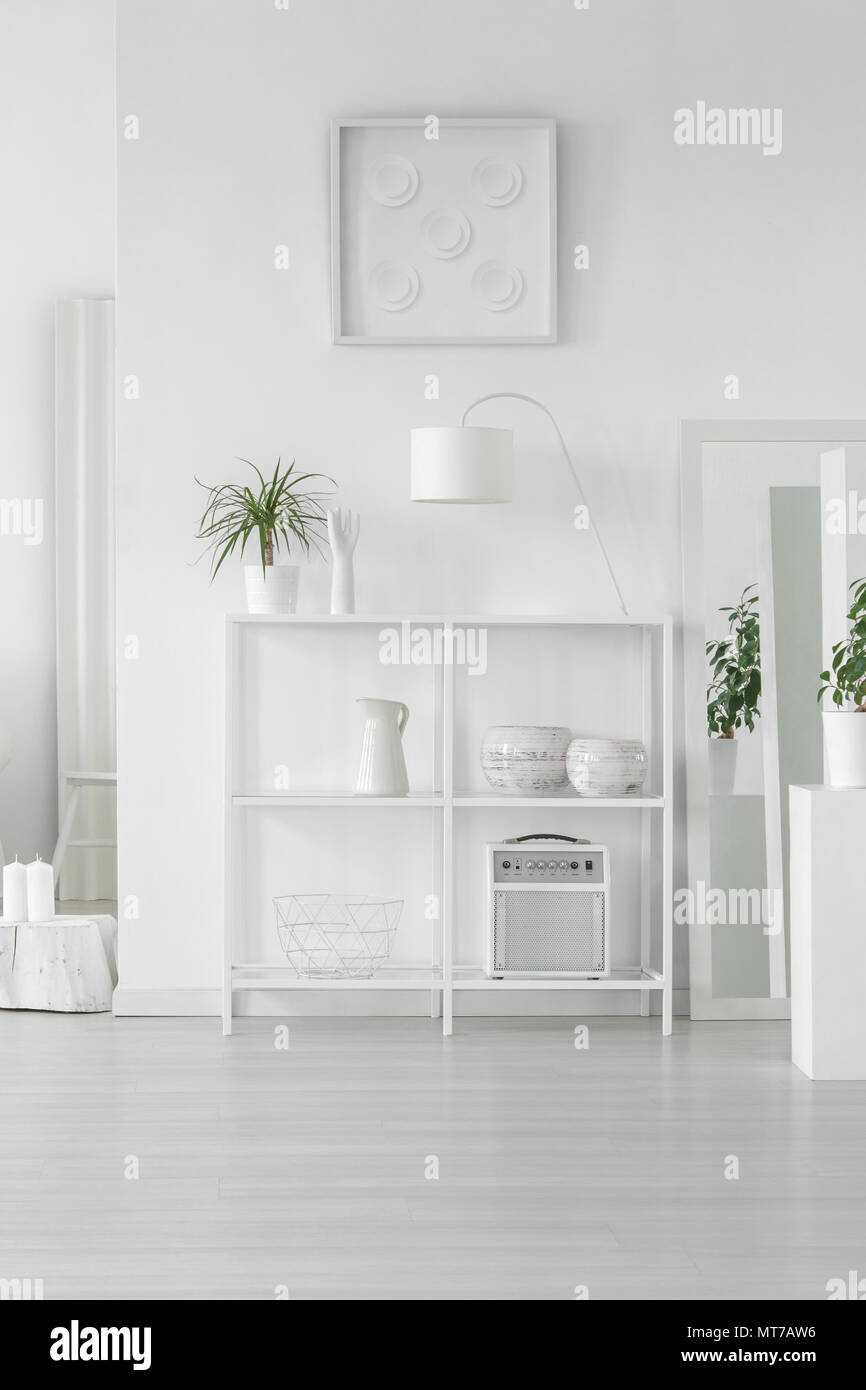 White Metal Rack With Fresh Plant, Simple Lamp And Decor Standing In Bright  Room Interior In Scandinavian Style