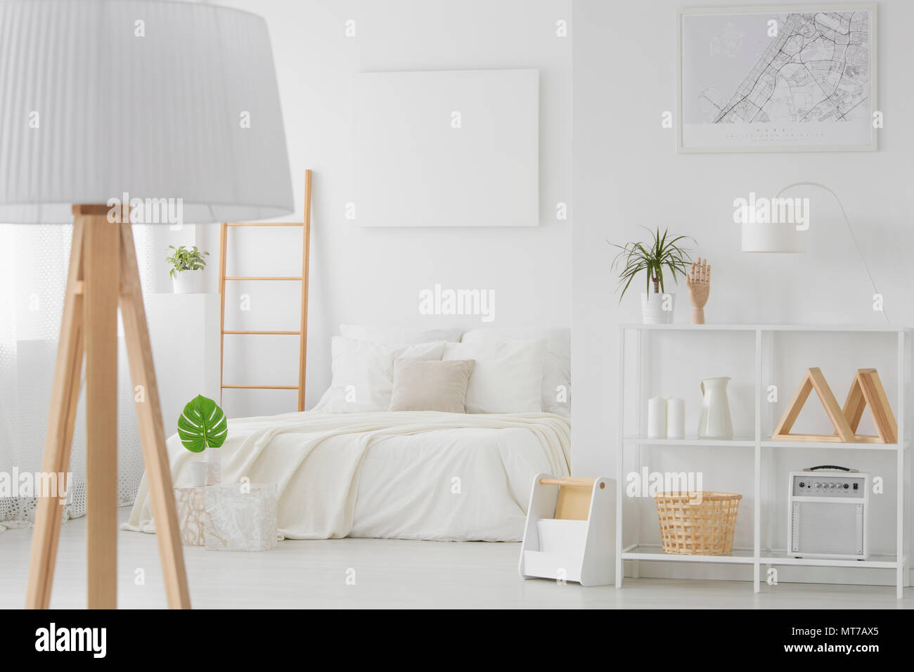 Empty Mockup Poster Hanging On The Wall Above King Size Bed In White Bedroom Interior With Wooden Decor Stock Photo Alamy