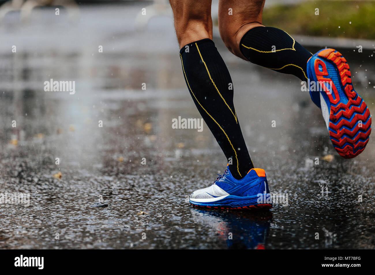 780178ebb2 foot men runner in compression socks running on rain asphalt on water