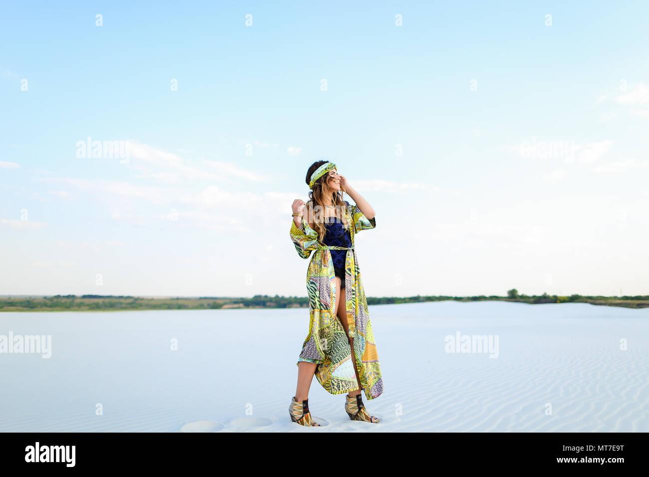 Female european photo model wearing black swimsuit and green bea - Stock Image