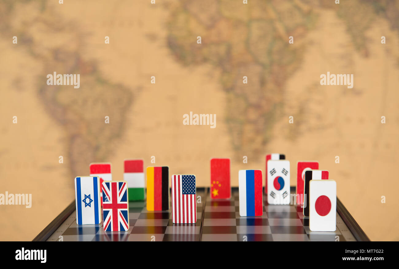 symbols of countries on the chessboard against against the ...