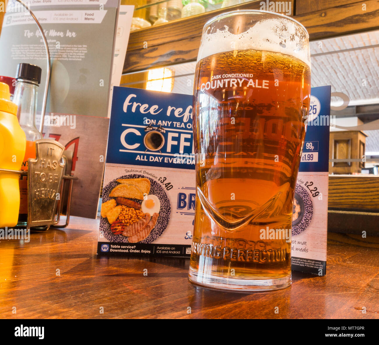 Pint of craft beer in front of menu in JD Wetherspoon pub in north east England. UK - Stock Image
