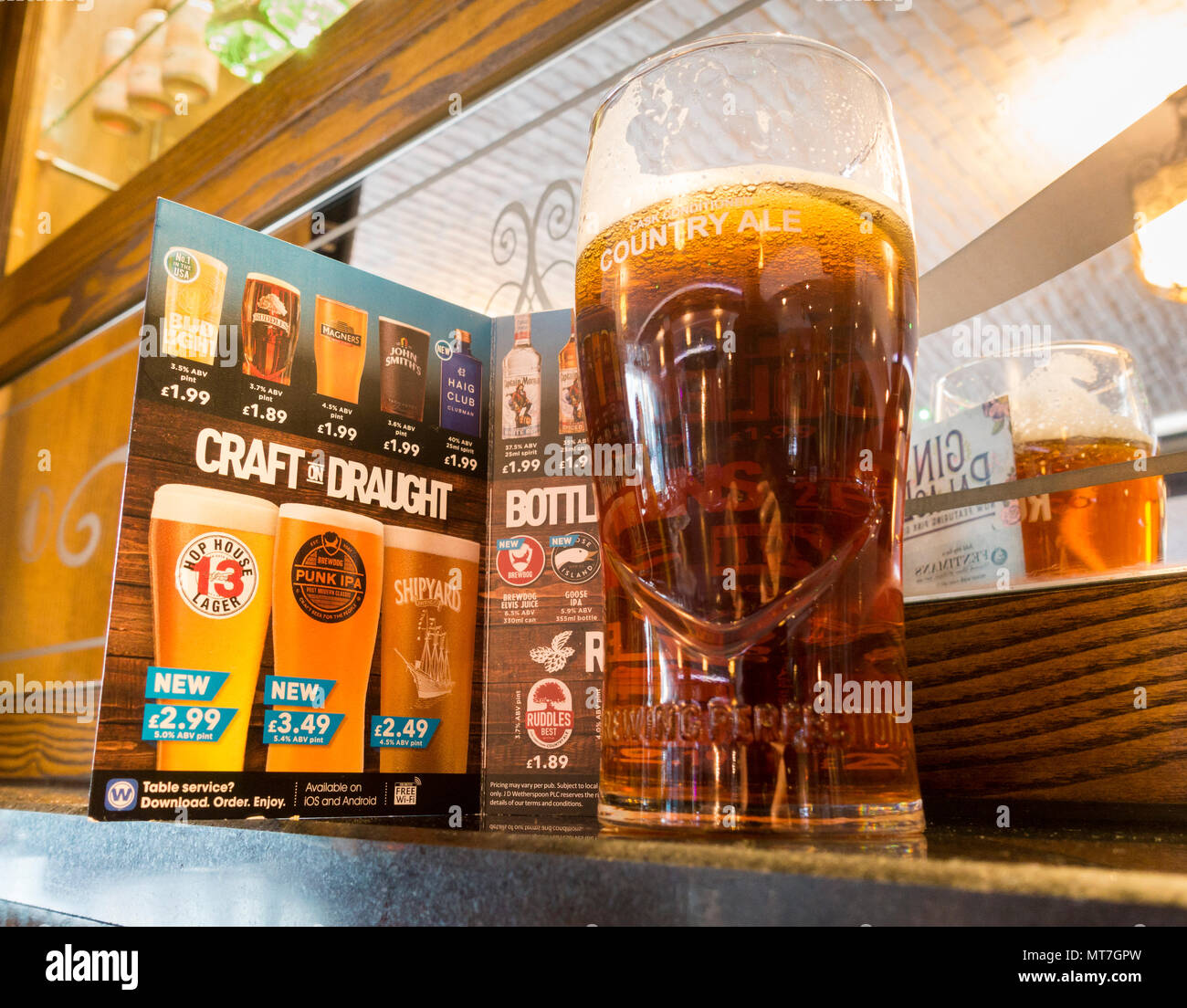 Pint of craft beer in front of menu in JD Wetherspoon`s pub in north east England. UK - Stock Image