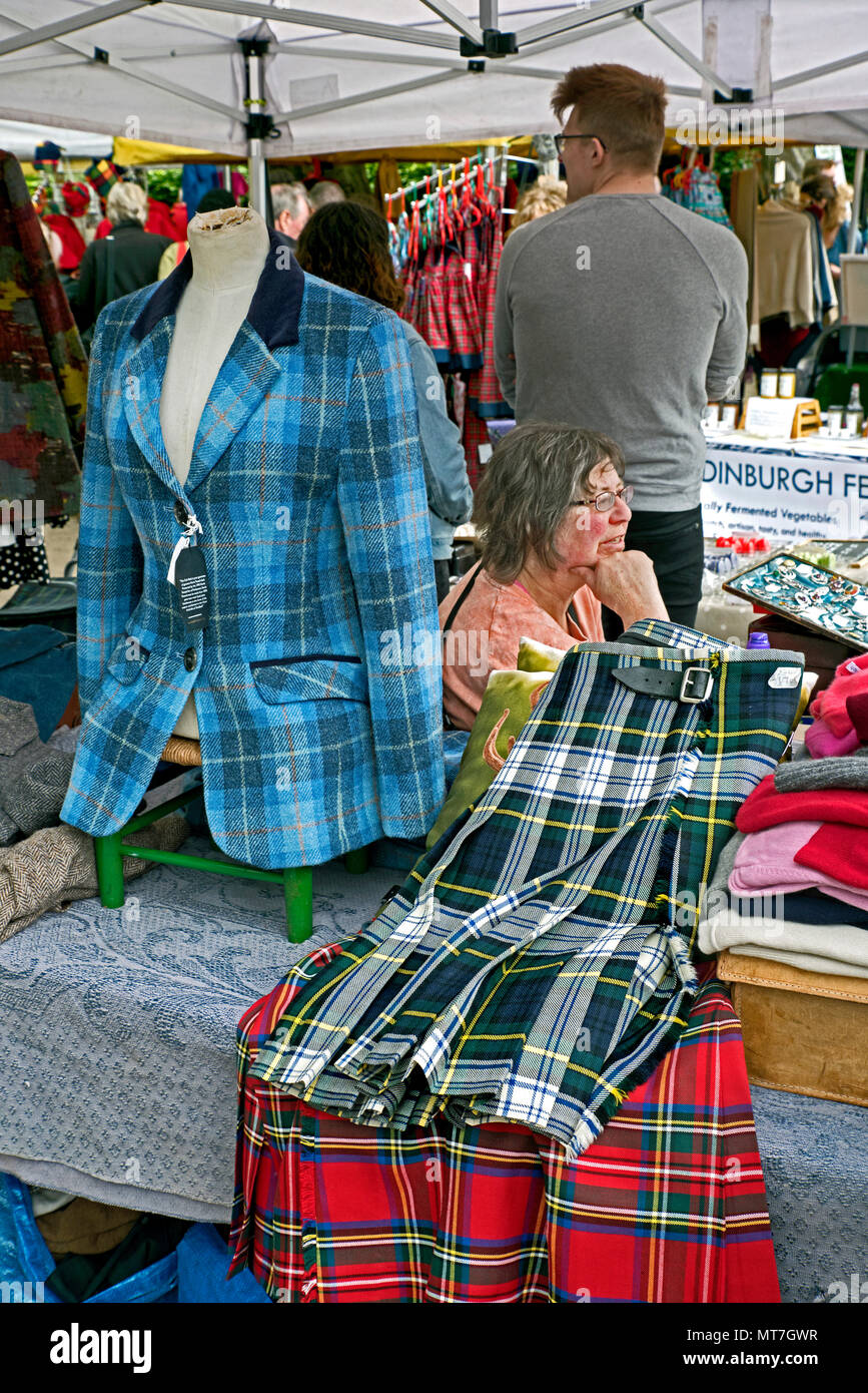 Tartan jacket and kilts for sale at Stockbridge Sunday Market in Edinburgh, Scotland, UK. - Stock Image
