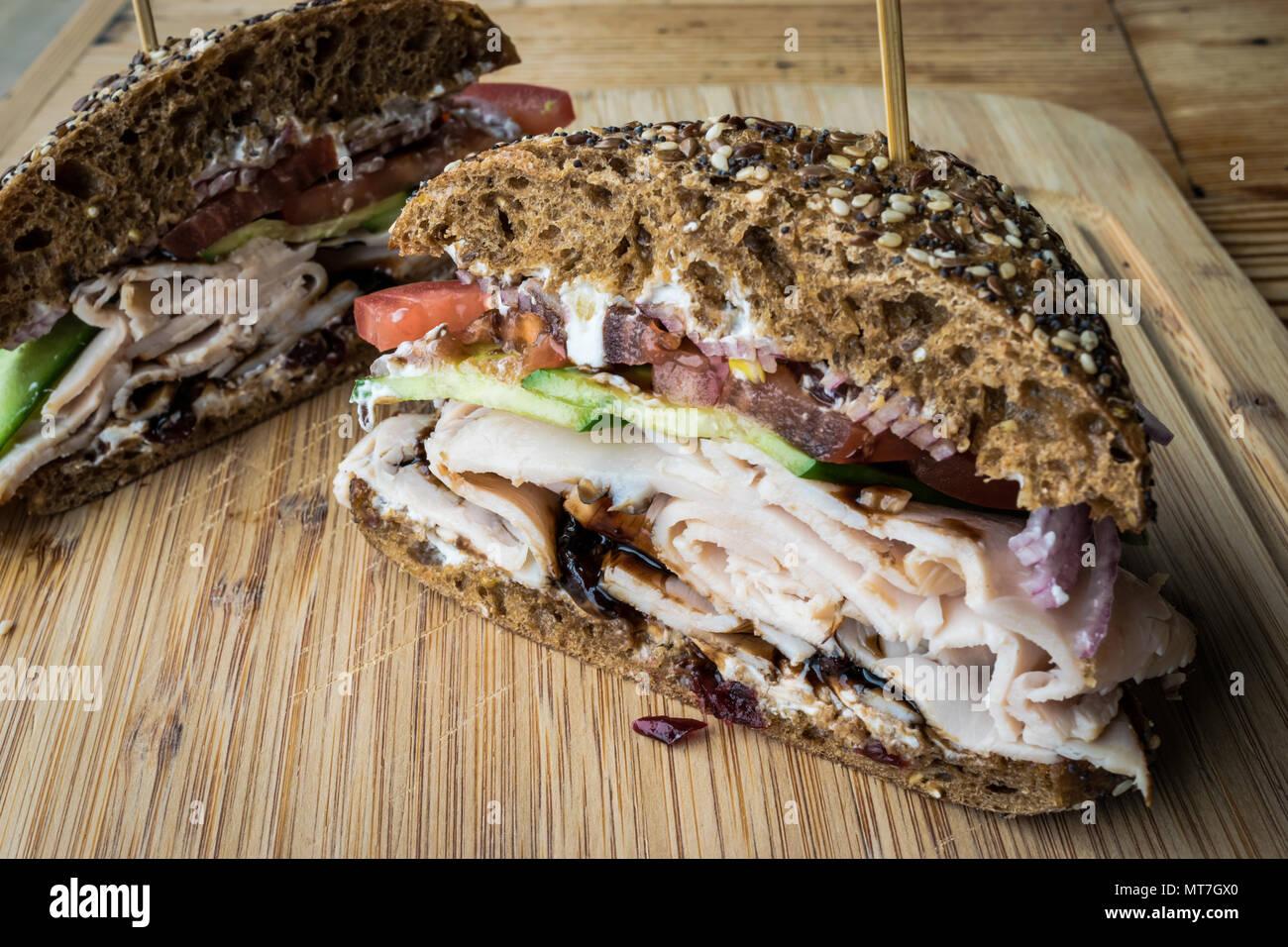 Sliced Turkey Sandwich On Wooden Platter Stock Photo Alamy