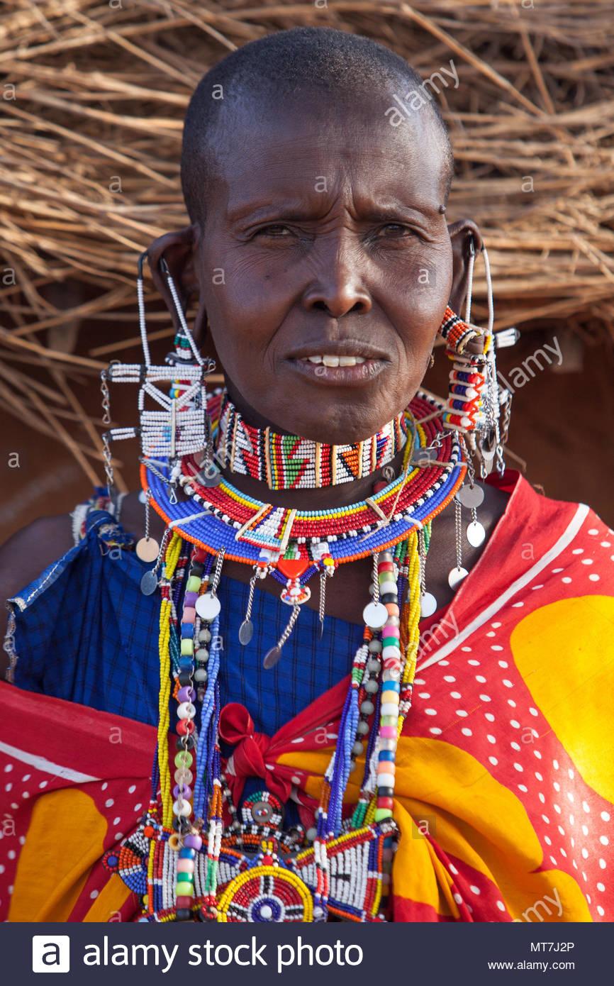 Beautiful; Masai women of Kenya, Africa in traditional clothing. - Stock Image