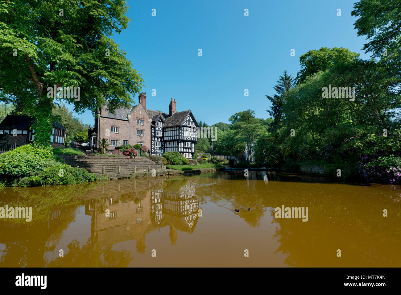 The Packet House is seen across the Bridgewater Canal in Worsley, Salford, Greater Manchester, UK. - Stock Image
