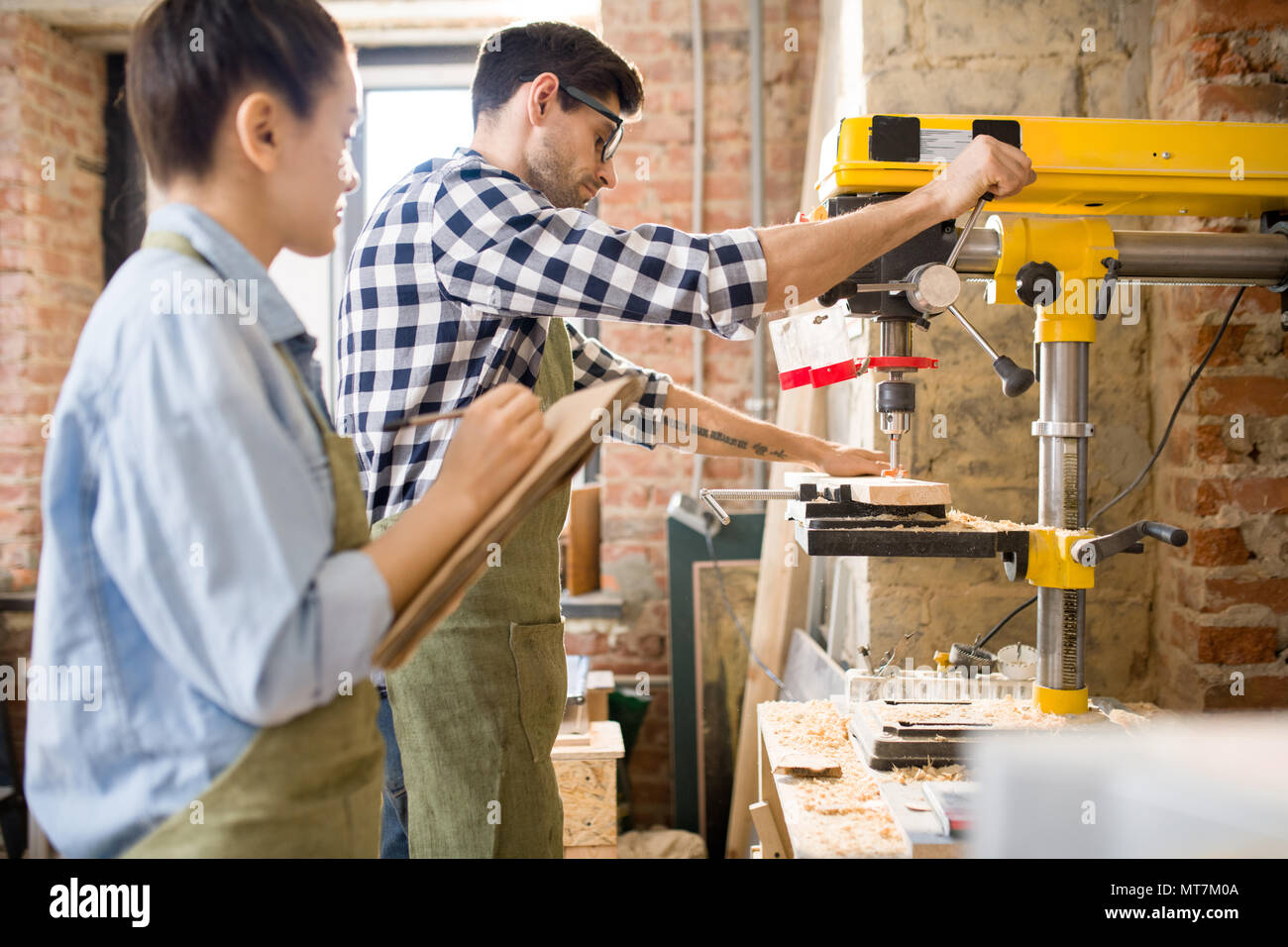 Two Carpenters Working with Wood - Stock Image