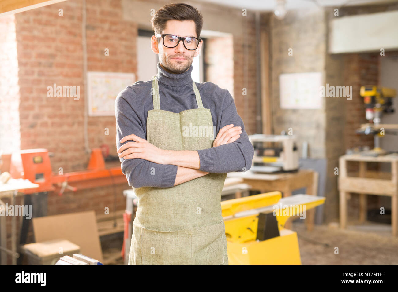 Modern Artisan Posing in Workshop - Stock Image