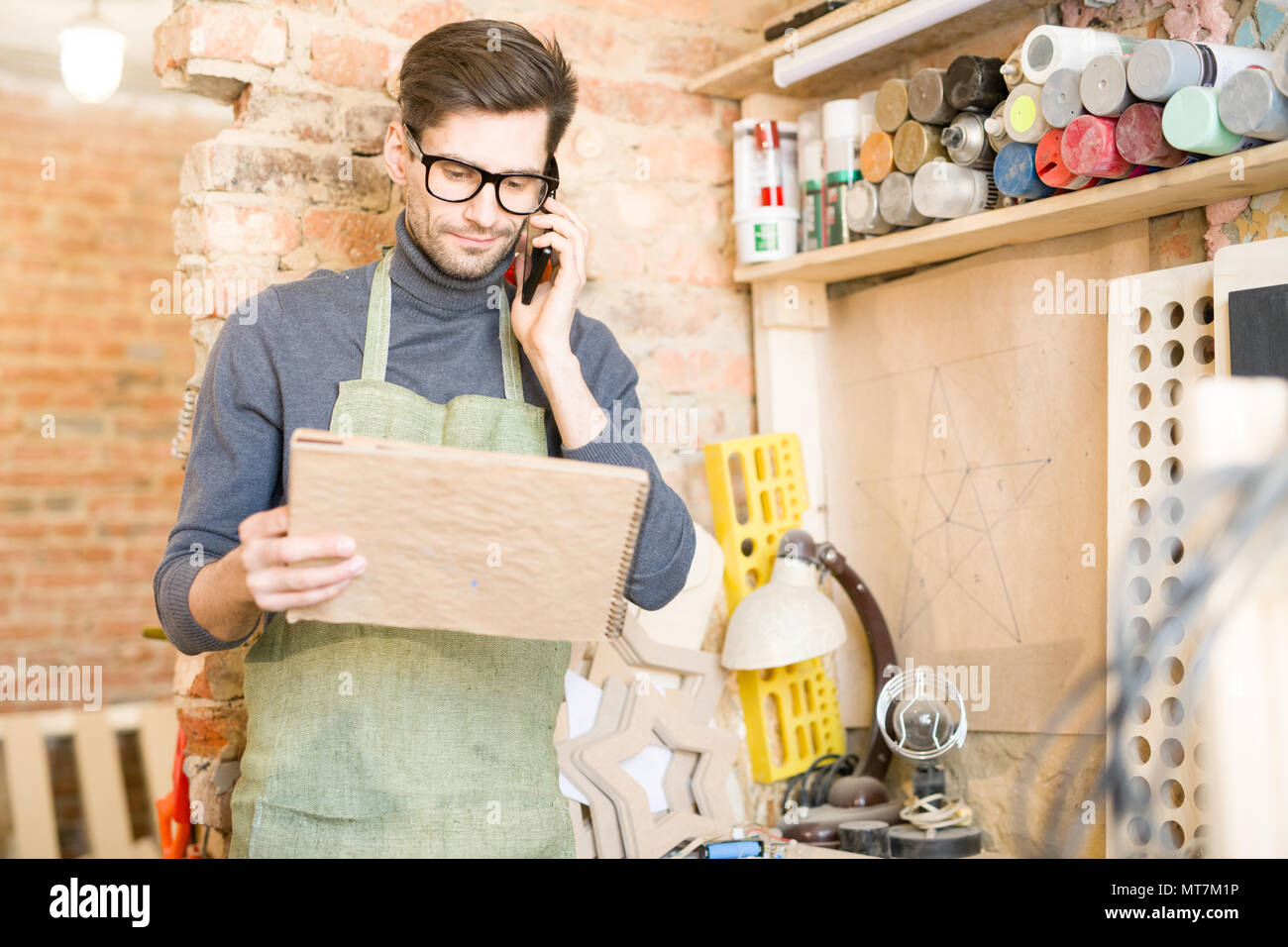 Artisan Speaking by Phone Stock Photo