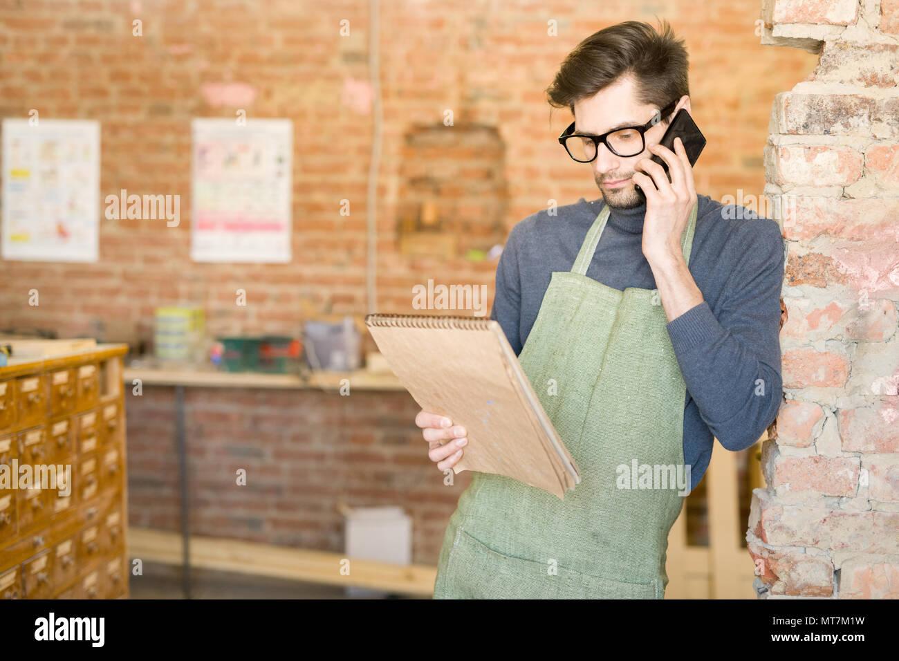 Modern Artisan Speaking by Phone Stock Photo