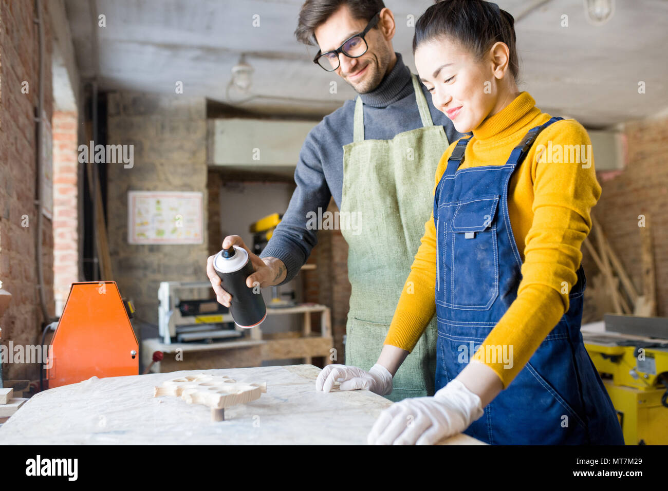 Two artists Doing Creative Woodwork - Stock Image
