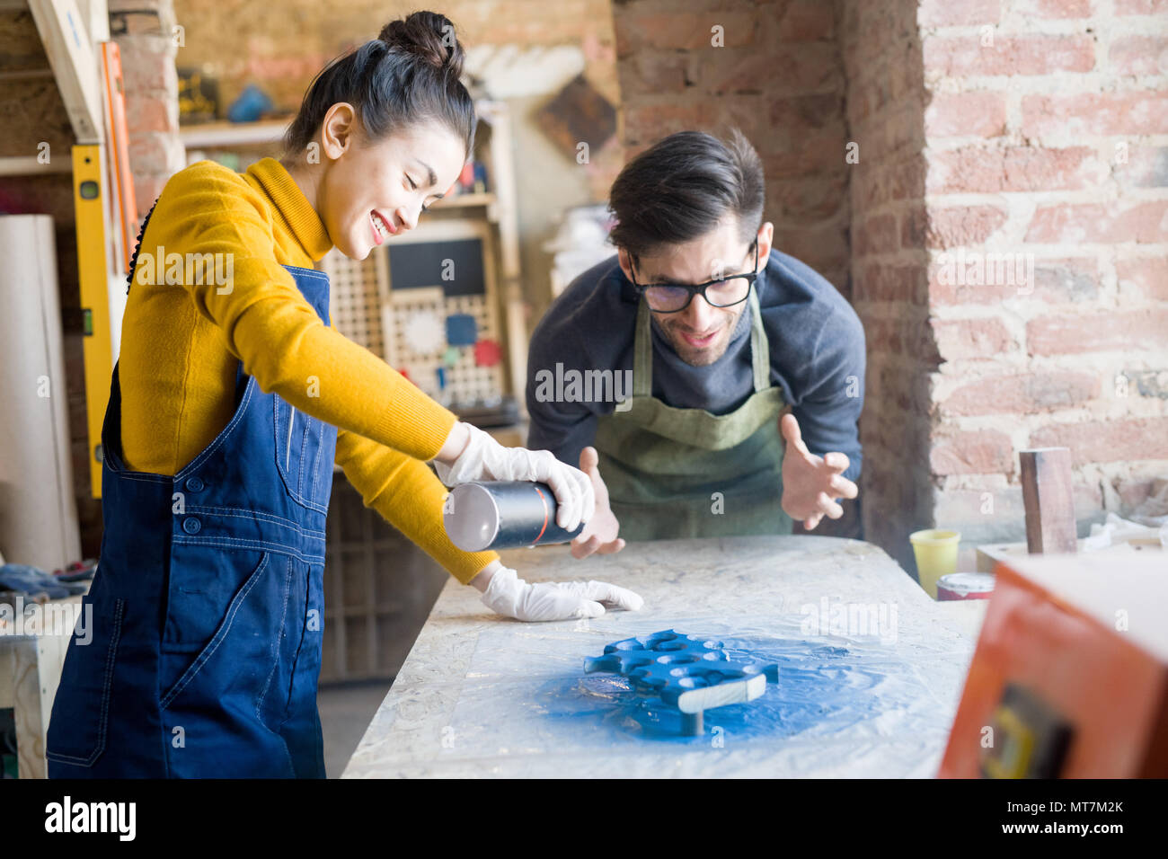 Excited Artisans Doing Creative Woodwork - Stock Image
