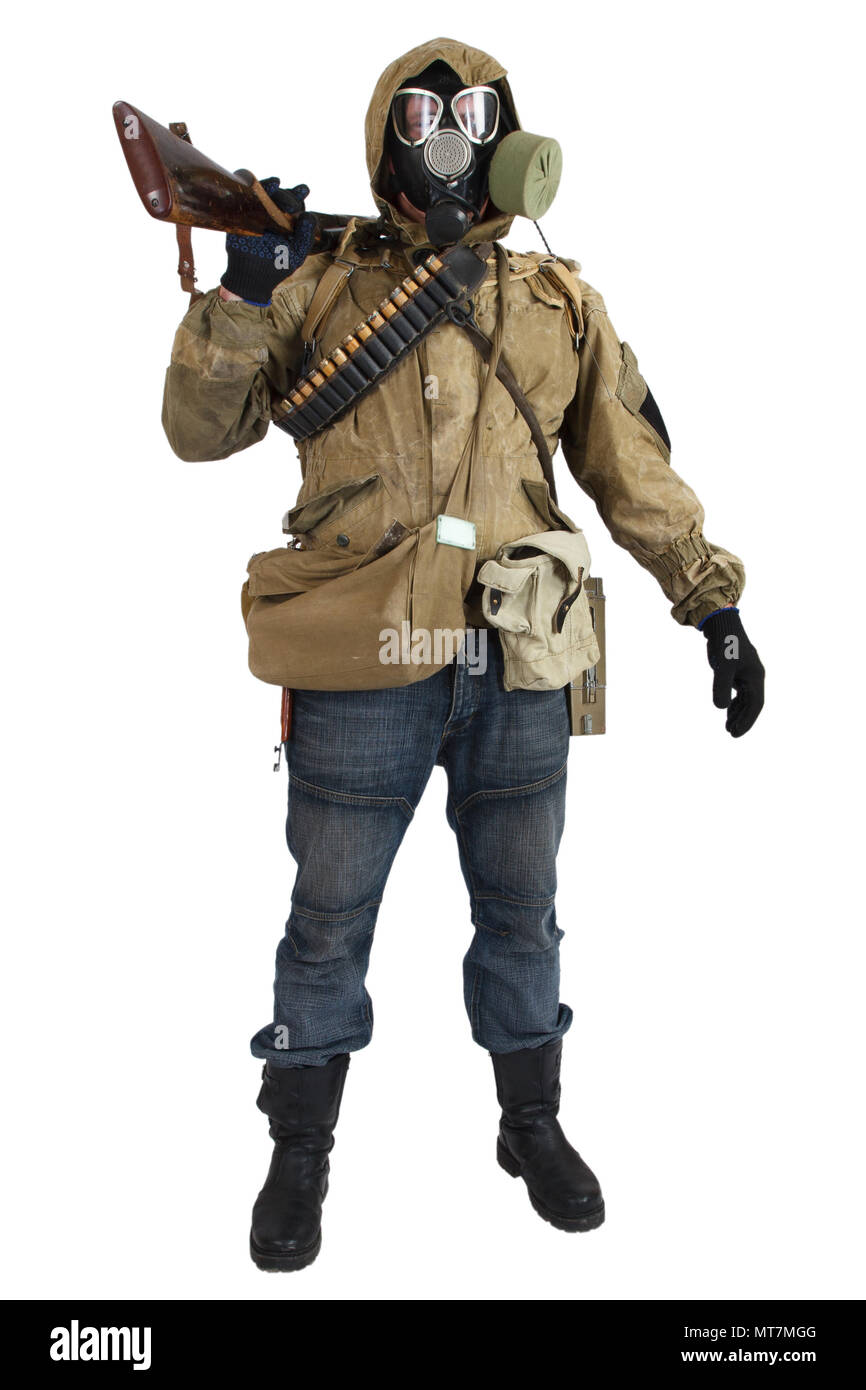 Stalker in gas mask with gun isolated on white - Stock Image