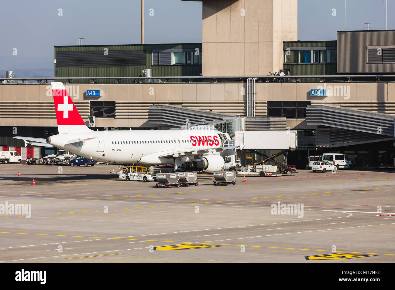 An Airbus A320-214 of the Swiss International Airlines at a terminal at Zurich airport. - Stock Image