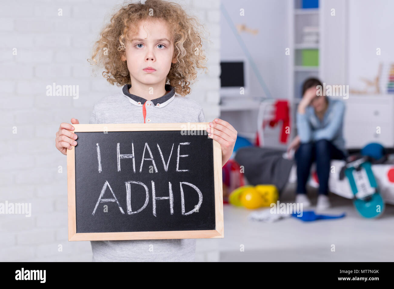 "Boy holding blackboard with ""i have ADHD"" text Stock Photo"