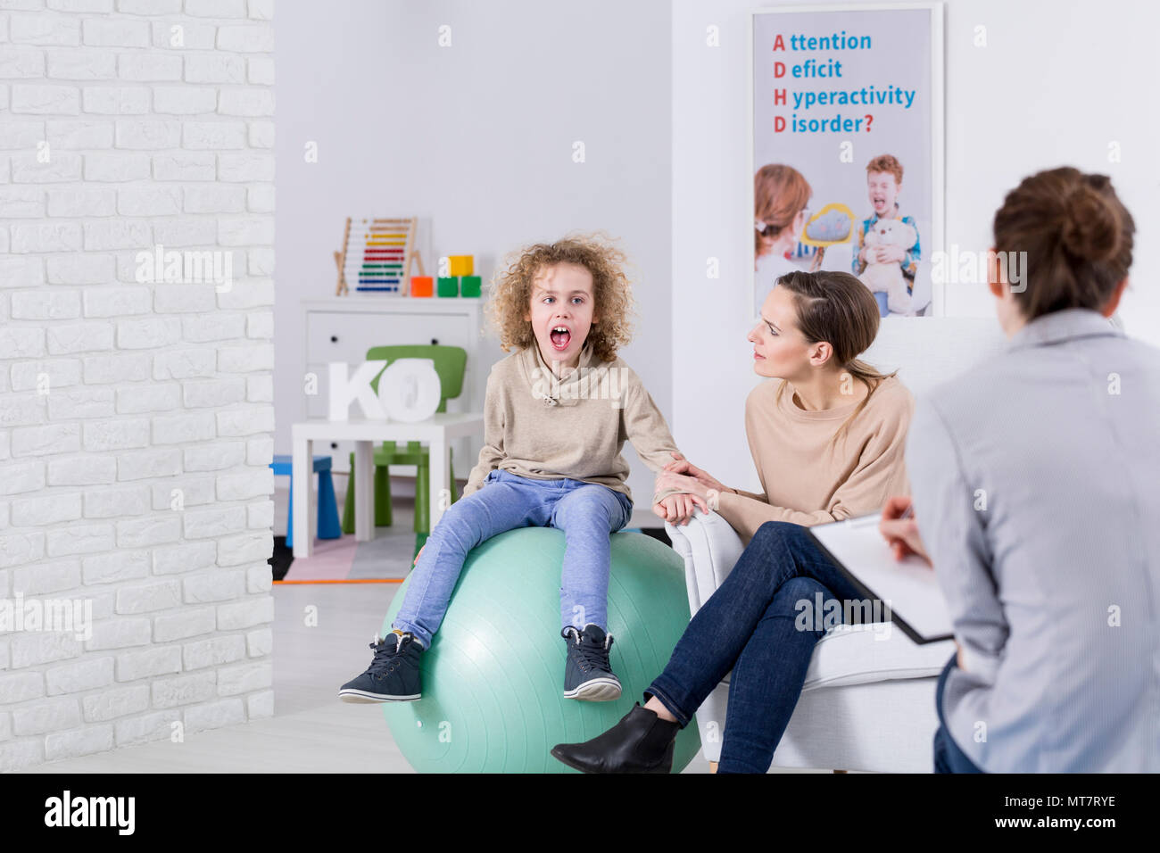 Mother and her child with ADHD during therapy - Stock Image