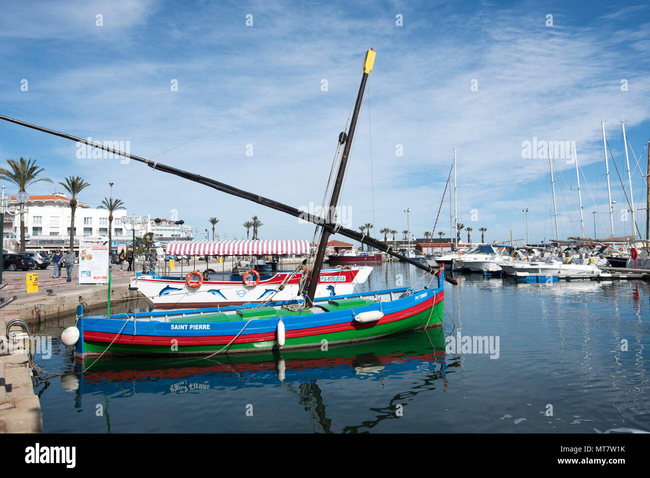 Traditional Barque Catalane Saint-Pierre in Saint-Cyprien Plage harbour, Roussillon, Pyrenees-Orientales, France - Stock Image