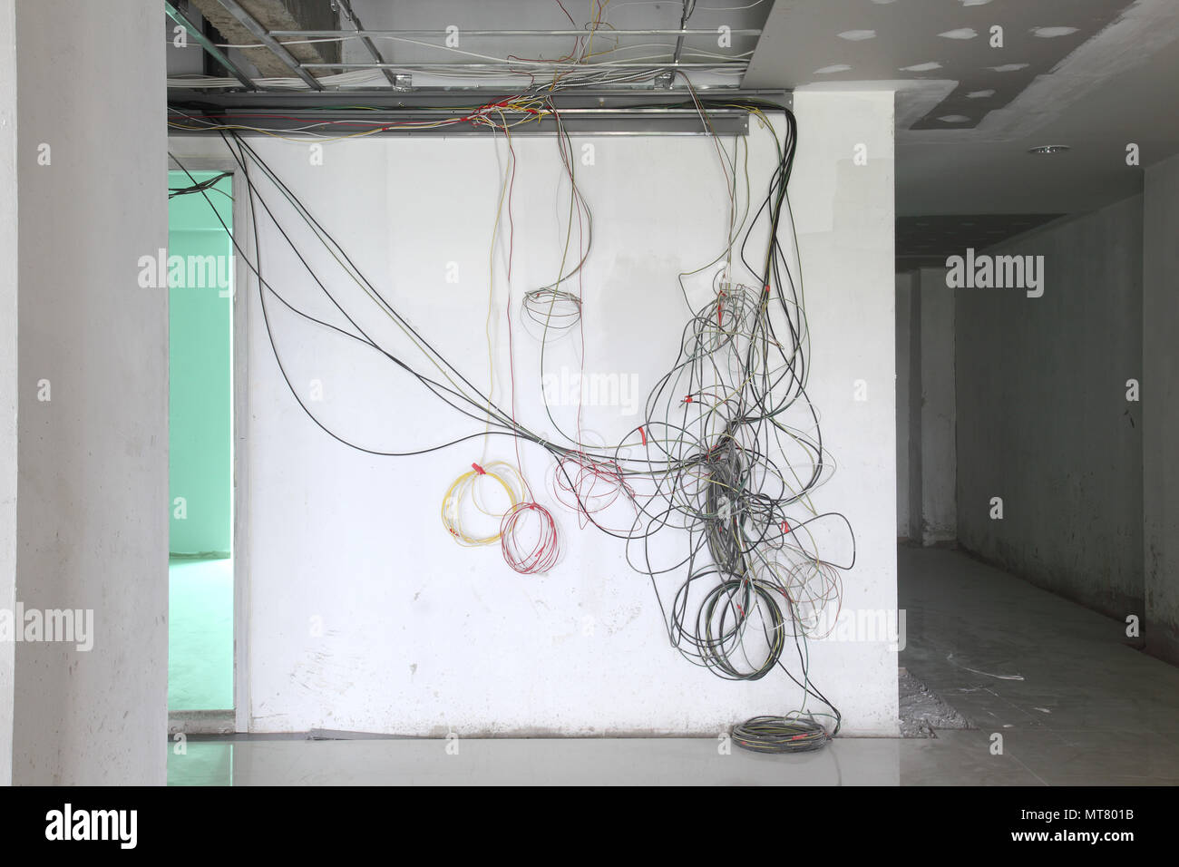 Finishing works at renovated apartment. Installation of wiring line ...