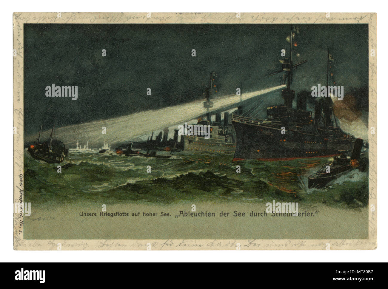 German historical postcard: The Navy lights its way with spotlights in the stormy sea, on a dark night. world war one 1914-1918. Germany. Stock Photo