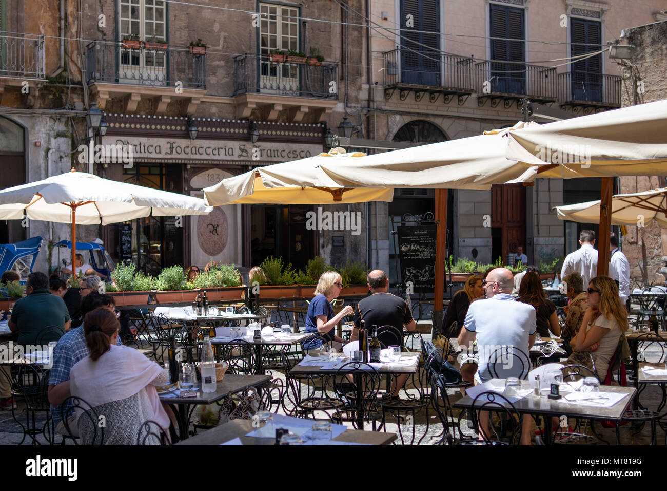 Palermo, Sicily, Italy - May 25, 2018: people dining outdoor on a sunny day at Antica Focacceria San Francesco, one of the city's oldest restaurants - Stock Image