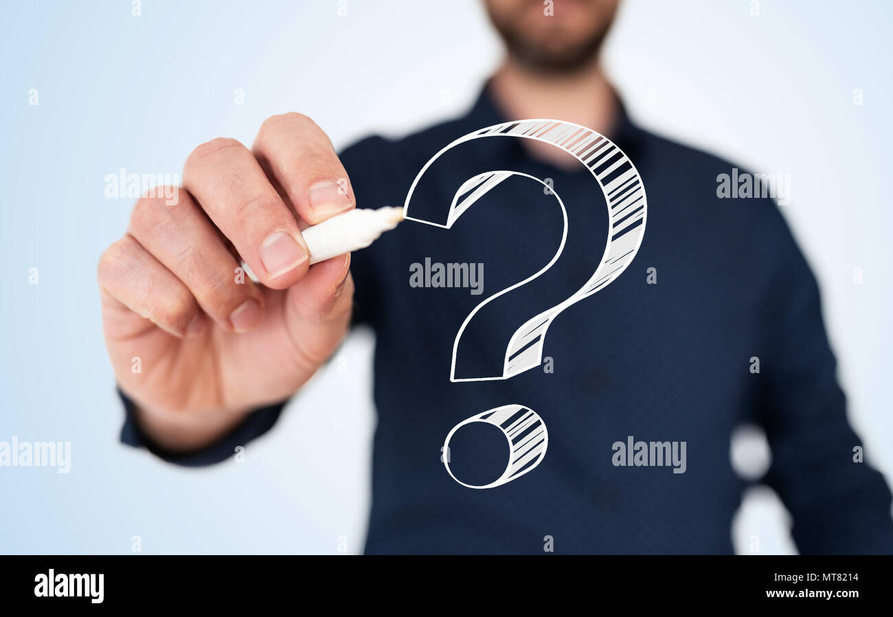 man in blue shirt with pen drawing question mark - Stock Image