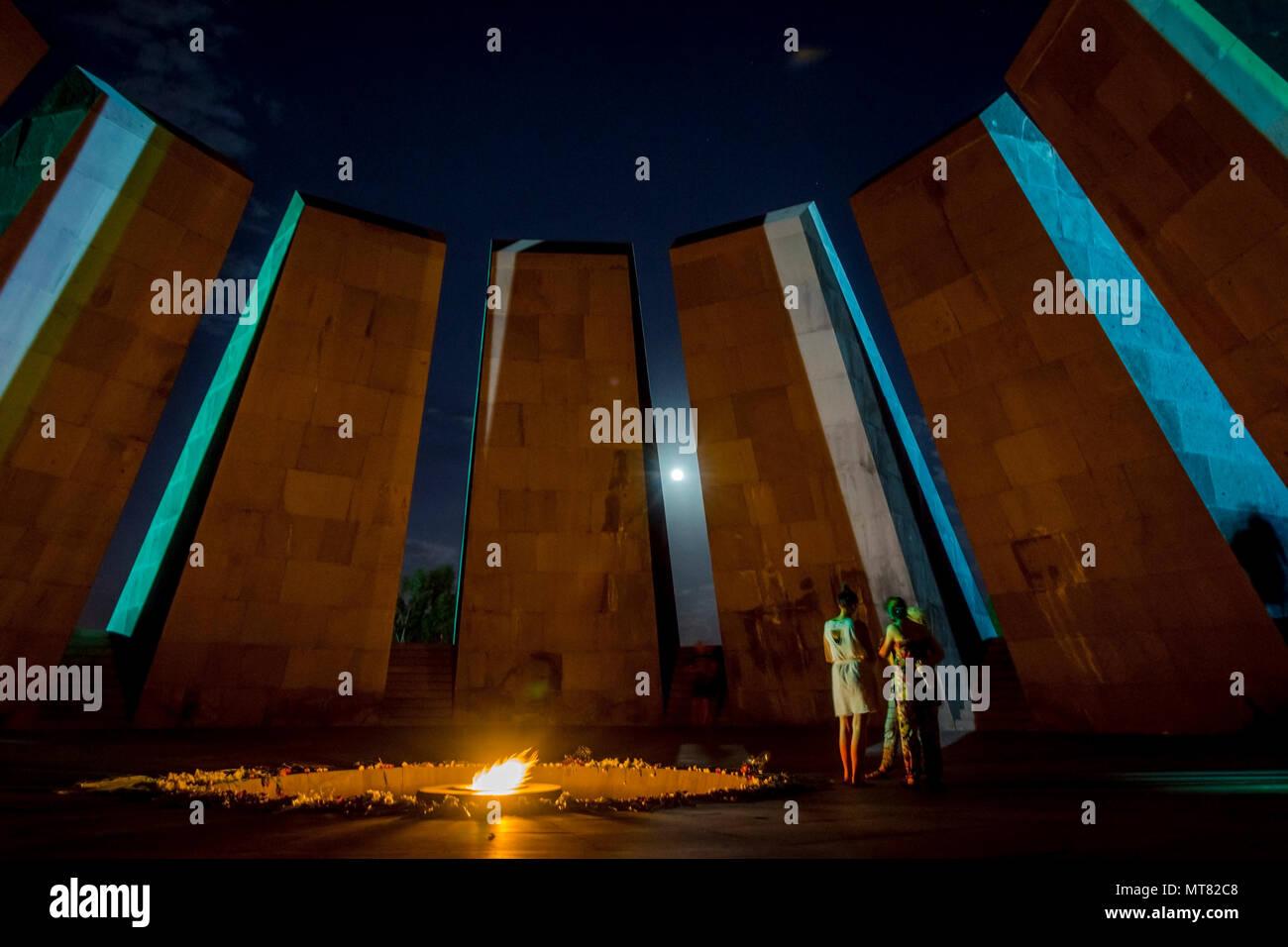 YEREVAN, ARMENIA - AUGUST 7: People visiting genocide memorial landmark in Yerevan and bringing flowers. August 2017 - Stock Image