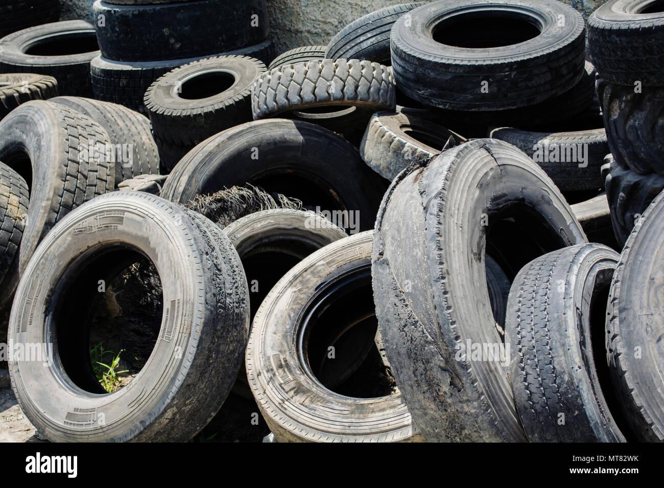 used car tires pile in the tire repair shop yard - Stock Image