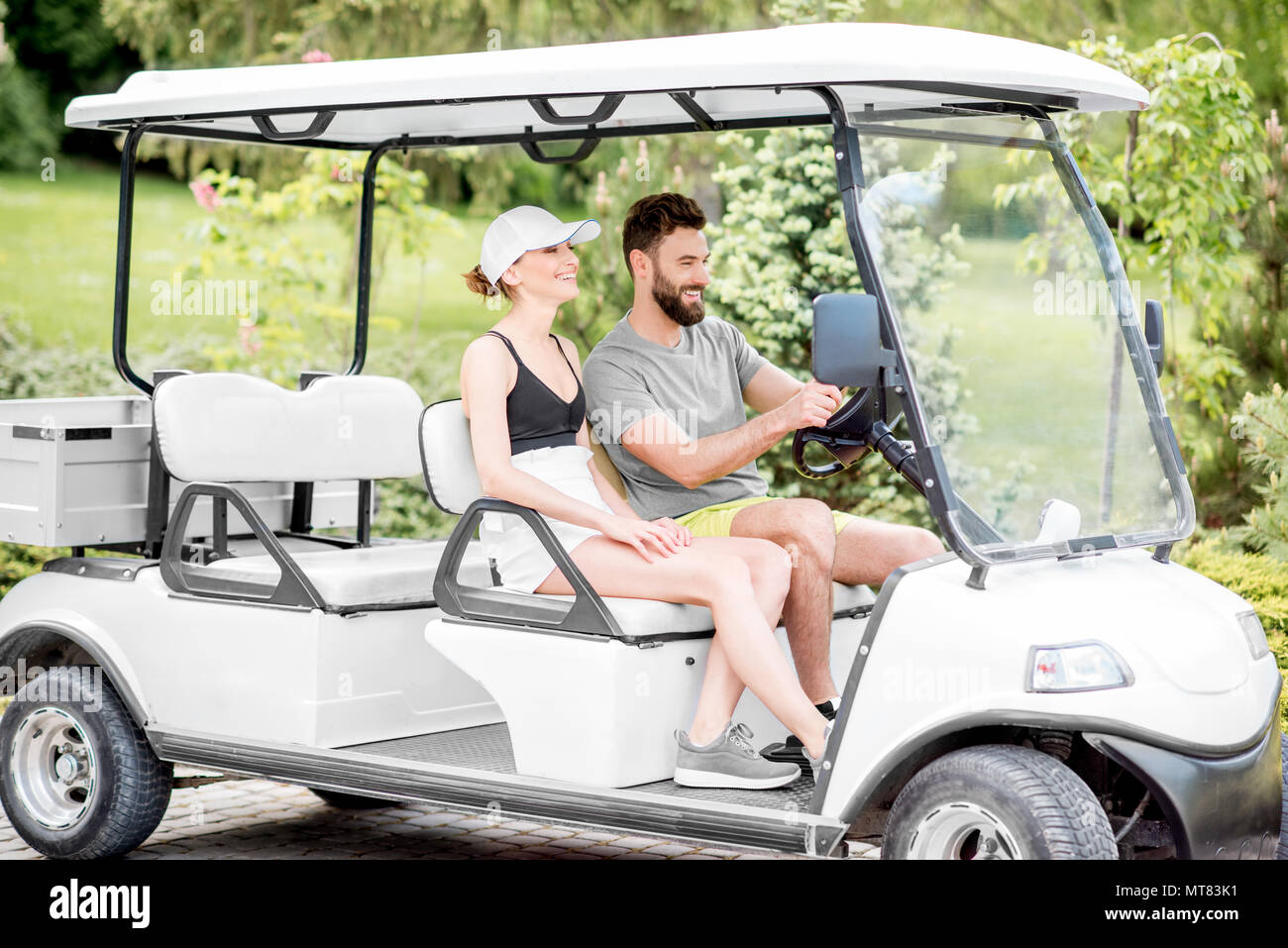 Couple in the golf cart - Stock Image