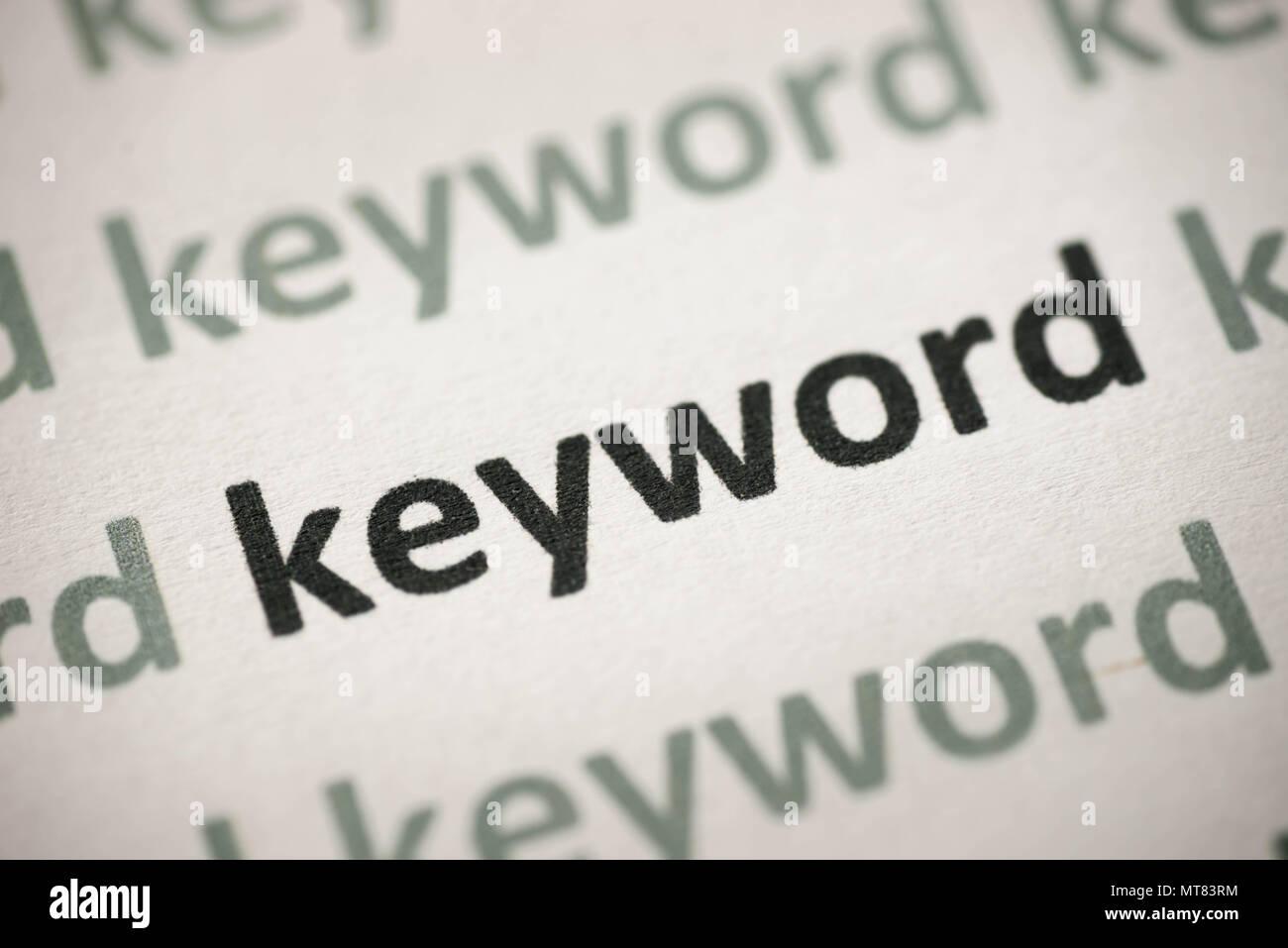 word keyword printed on white paper macro - Stock Image