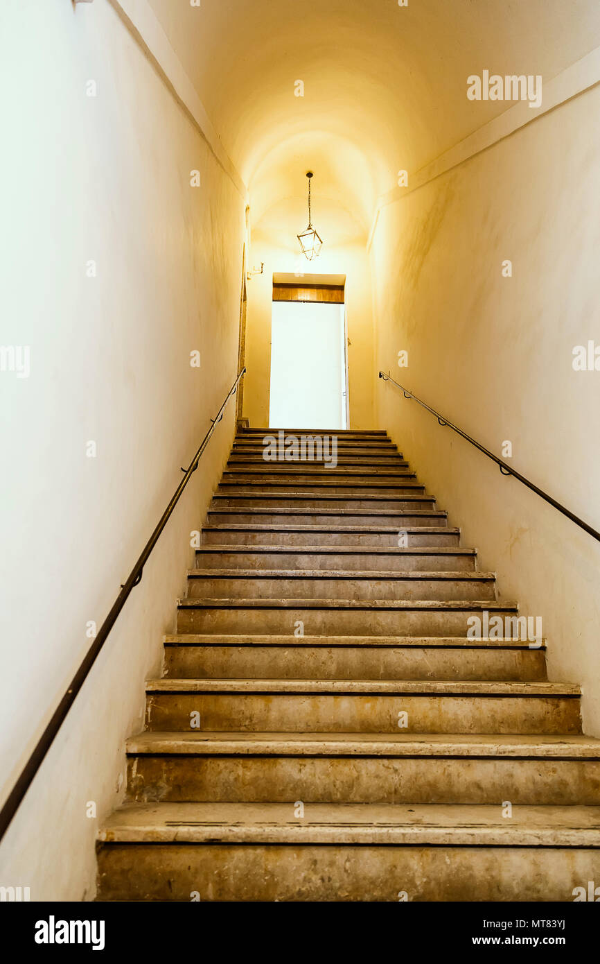 Charming Old Staircase With Metal Wall Mounted Handrail, Ancient Architecture.  Selective Focus.