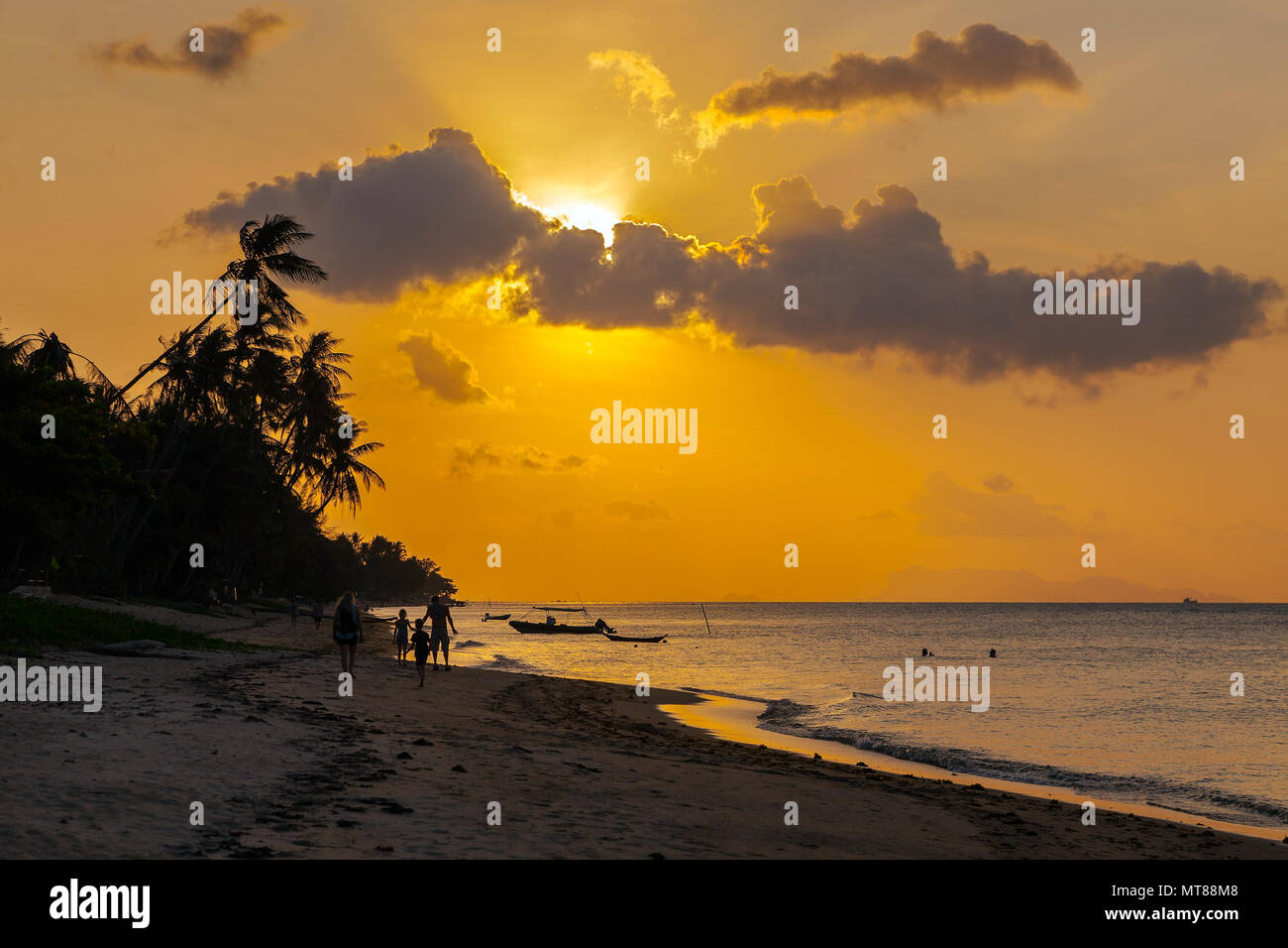 Sunset on the beach of Bang Por on Koh Samui in Thailand - Stock Image