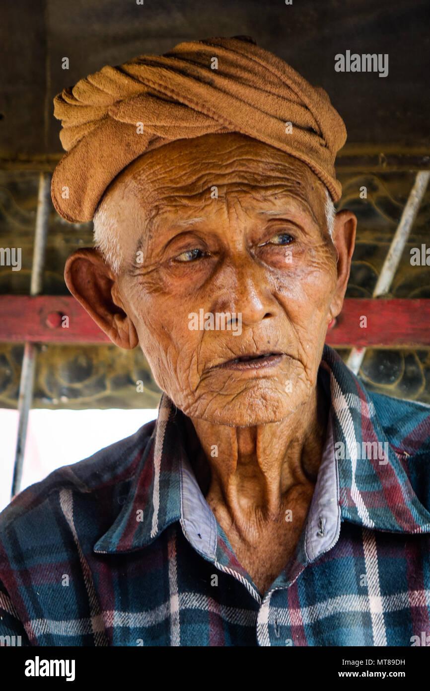 Mandalay, Myanmar - Feb 22, 2016. Portrait of Burmese old man at countryside in Mandalay, Myanmar. Stock Photo