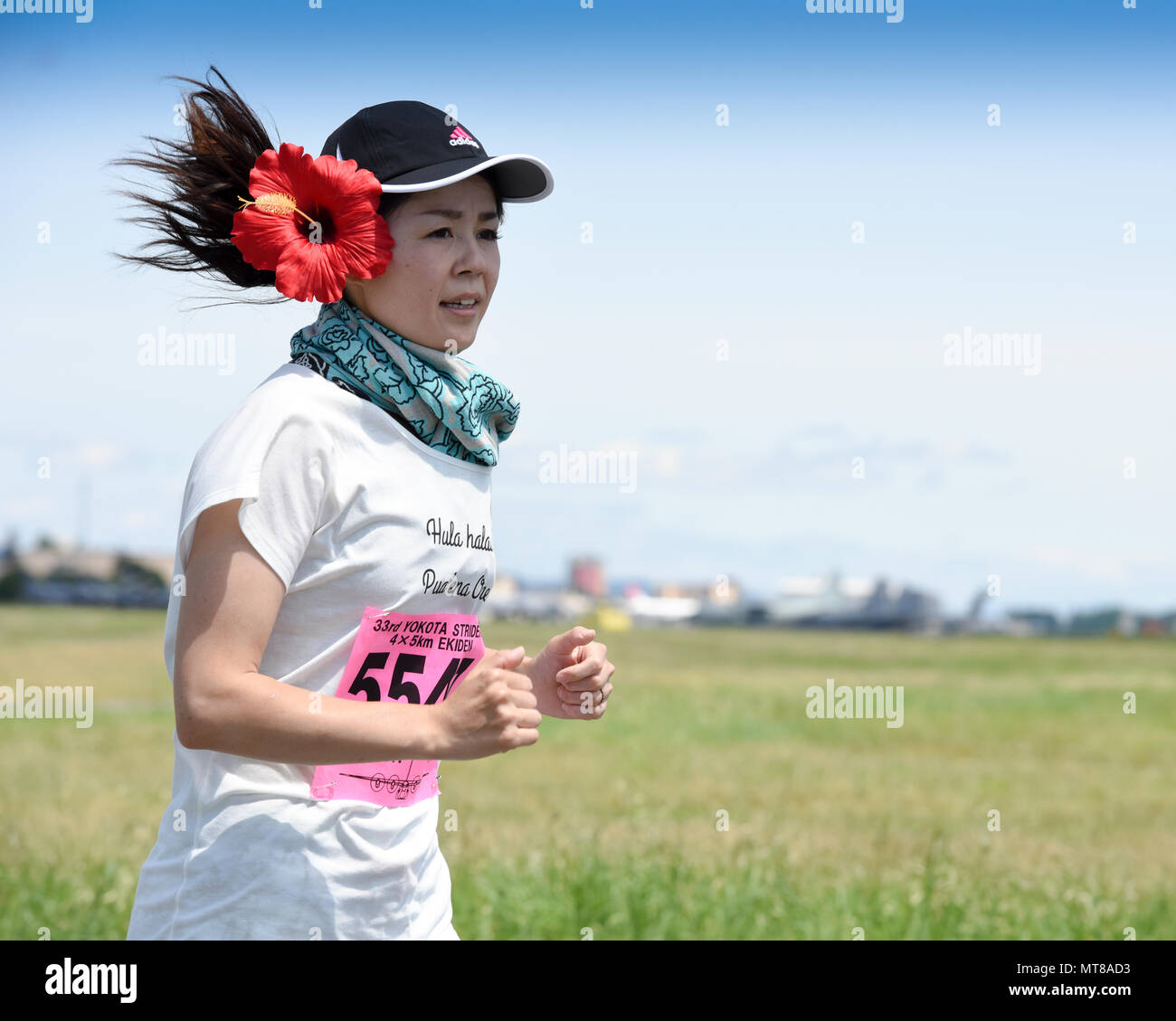 A runner participates in the 5K Race during the 33rd Annual Yokota Striders Ekiden at Yokota Air Base, Japan, June 4, 2017. The races, which consisted of a 2K Kids Run, 2K Family Run, 5K Race and the main Ekiden Race event, promoted friendship and  physical fitness. (U.S. Air Force photo by Machiko Arita) - Stock Image