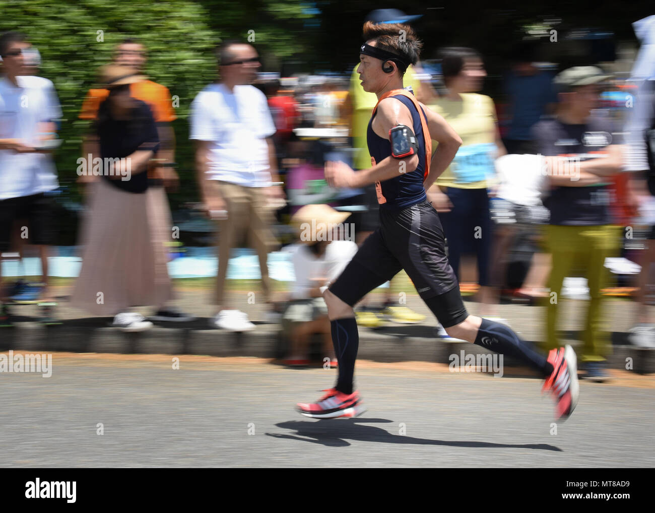 A participant runs the Ekiden Race at Yokota Air Base, Japan, June 4, 2017. More than 5,000 runners participated in the event hosted by the Yokota Striders Running Club. (U.S. Air Force photo by Machiko Arita) - Stock Image