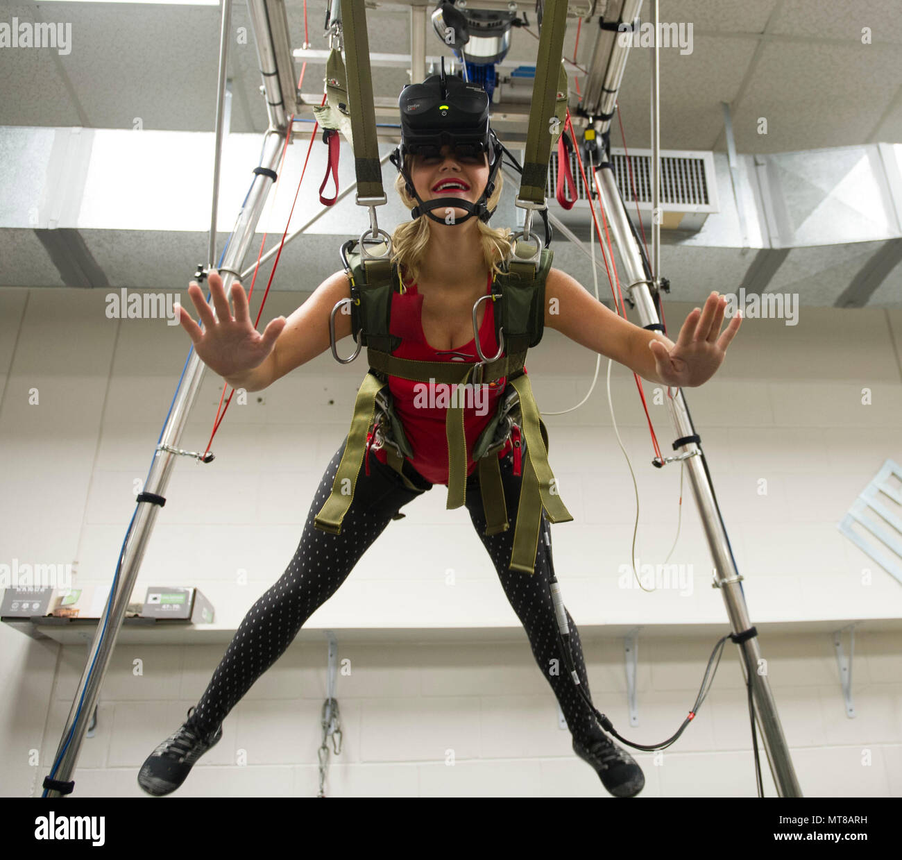 Demi, a Tampa Bay Buccaneers cheerleader, experiences freefall in the MC-60 parachute simulator at the parachute rigging facility while visiting MacDill Air Force Base in Tampa, Fla., Nov. 7, 2017. The cheerleaders toured U.S Special Operations Command and other base facilities to meet with service members and to get a glimpse of military life. (Photo by Army Sgt. Jose Reyes) Stock Photo