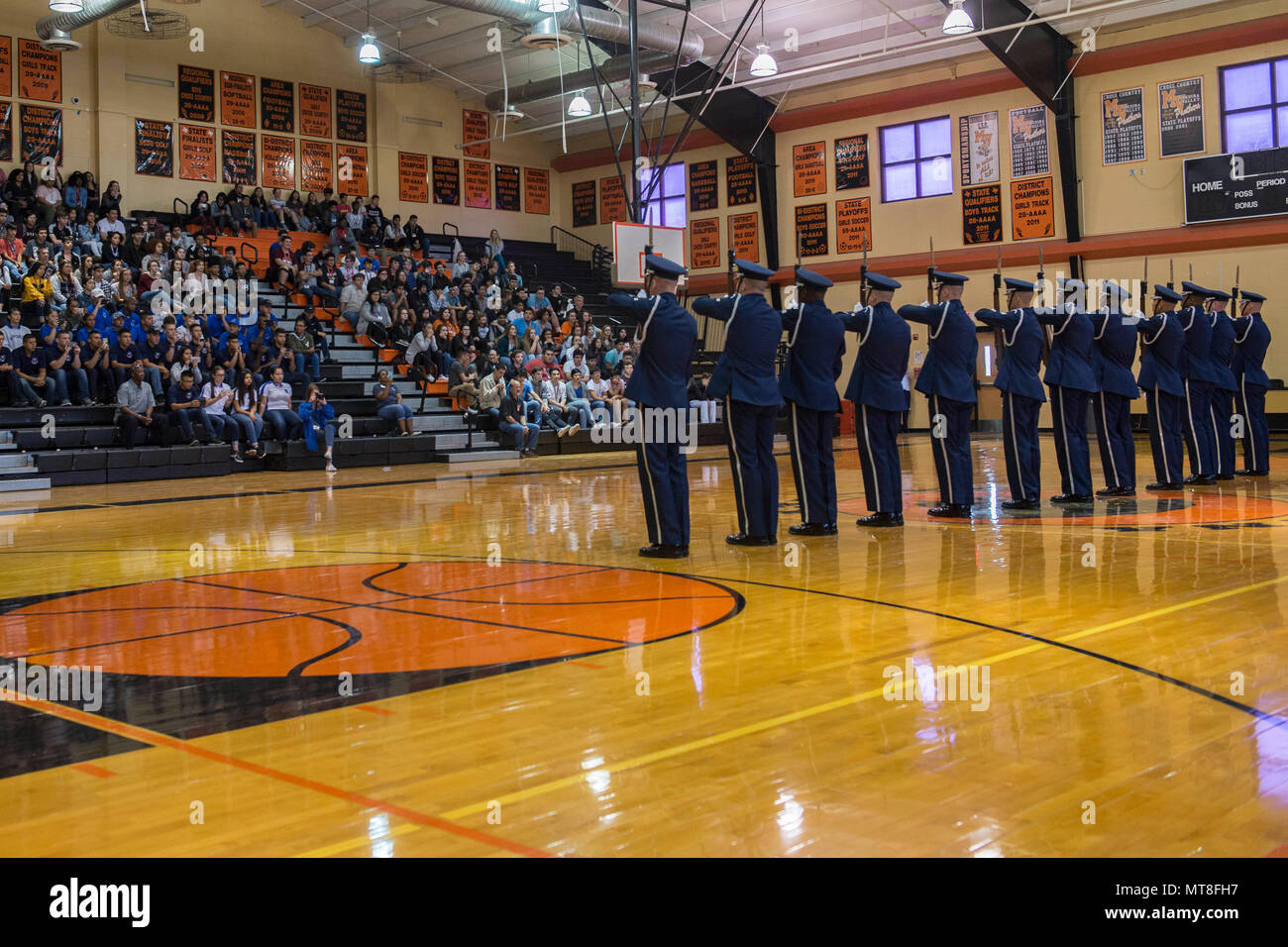 The U S  Air Force Drill Team performs in front of students