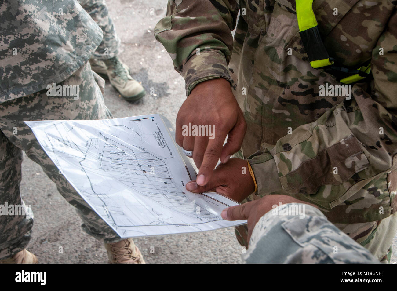 Members of the Hawaii National Guard review a map in response to a volcano outbreak May 12, 2018, at Leilani Estates, Pahoa, Hawaii. More than 100 soldiers and airmen have been activated to form Task Force Hawaii, which is assisting government agencies by providing presence patrols in affected and traffic guidance in affected neighborhoods. (U.S. Air National Guard photo by Senior Airman John Linzmeier) - Stock Image