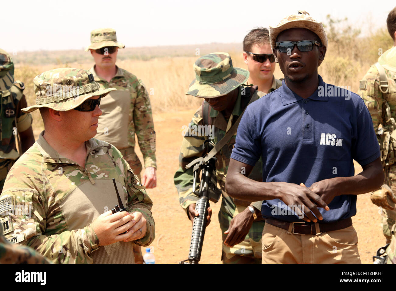 Birame Faye, an Interpreter for the Senegalese Army is responsilble for translating French to English and English to French between Soldiers of 3rd Squadron, 71st Cavalry Regiment, 10th Mountain Division and the Senegalese Army. This is absolutely critical to a successful mission. 10th Mountain began training instructors of the Senegalese Army April 30, 2018 to better prepare them for leading their upcoming Advanced Infantry Training. (U.S. Army Photo by Staff Sgt. Brandon Ames) - Stock Image