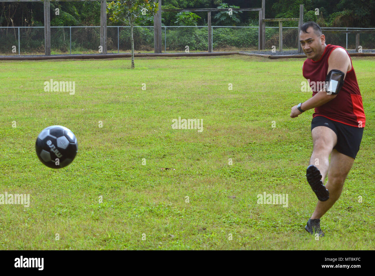 A Singapore Army Soldier Kicks A Soccer Ball During A Match During Tiger Balm 18 S Sports Day At The 298th Regiment Multi Functional Training Unit Mftu Regional Training Institute Rti Waimanalo Hawaii On