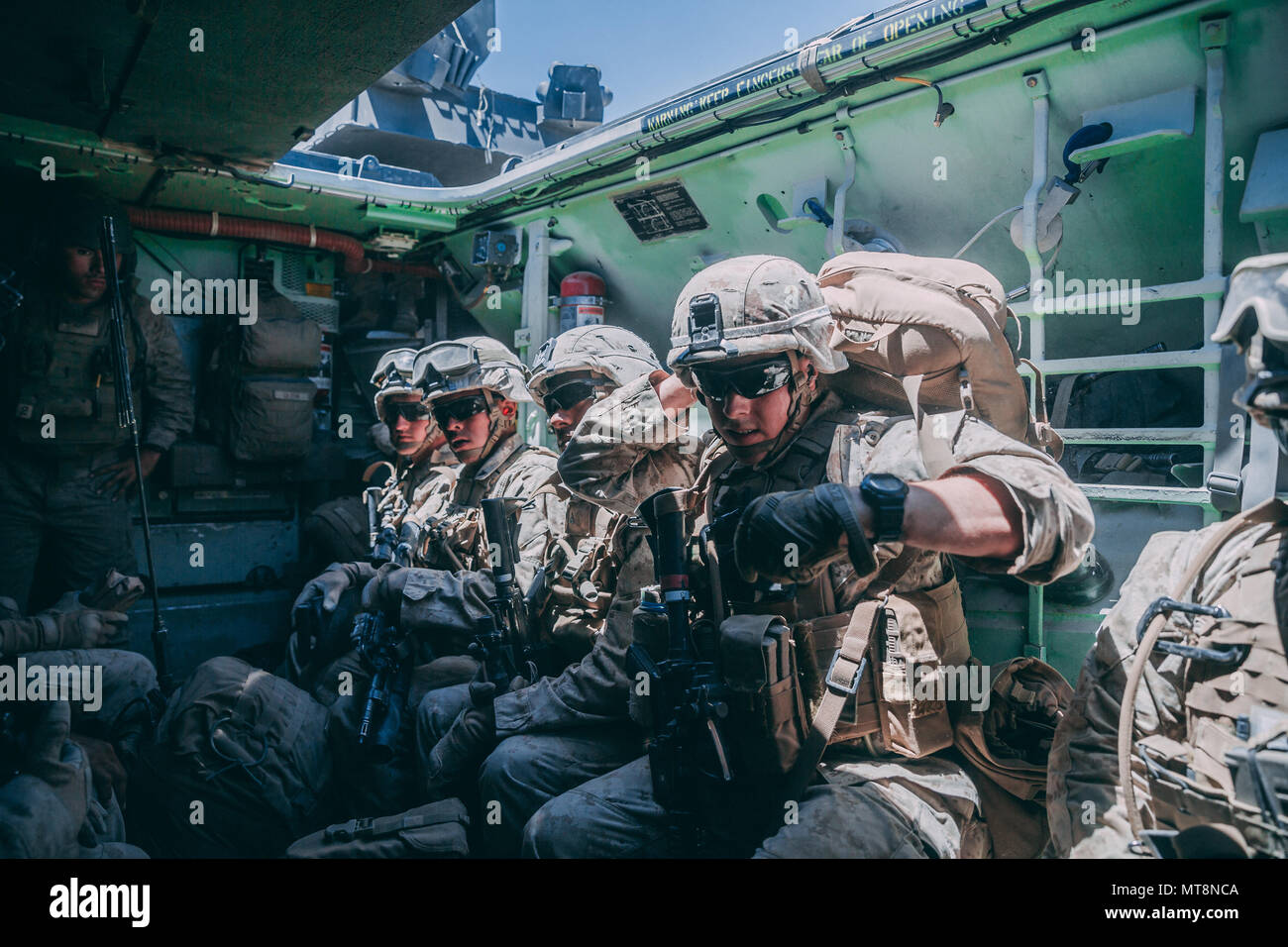 Marines With 3rd Battalion 2nd Marine Regiment 2nd Marine Division Wait Inside An Amphibious Assault Vehicle