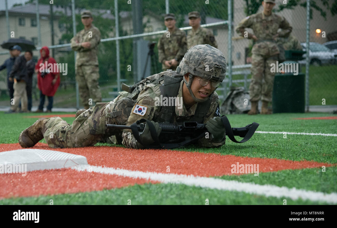 Cpl. Choi, Ji Heon, a native of Seoul, South Korea, assigned to 65th Medical Brigade, high-crawls at the physical fitness challenge during the Eighth Army 2018 Best Warrior Competition, held at Camp Casey, Republic of Korea, May 17. The Eighth Army BWC is being held to recognize and select the most qualified junior enlisted and non-commissioned officer to represent Eighth Army at the U.S. Army Pacific Best Warrior Competition at Schofield Barracks, HI, in June. The competition will also recognize the top performing officer, warrant officer and Korean Augmentation to the U.S. Army soldier at th Stock Photo