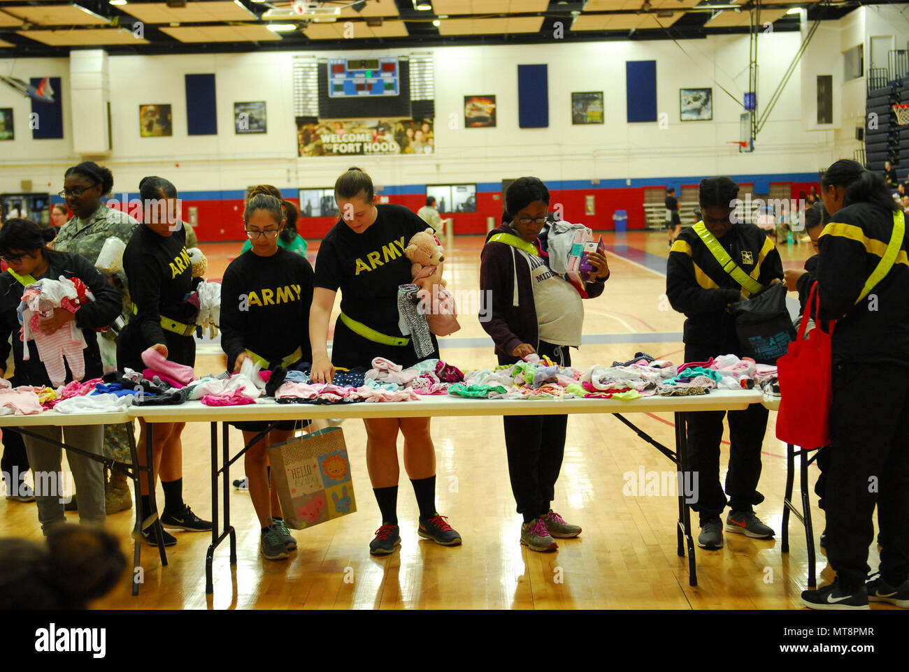 Female Soldiers from Pregnancy Postpartum Physical Training (P3T) look at baby clothes during P3T Mother's Day baby clothing swap on Friday at Abrams gym. - Stock Image