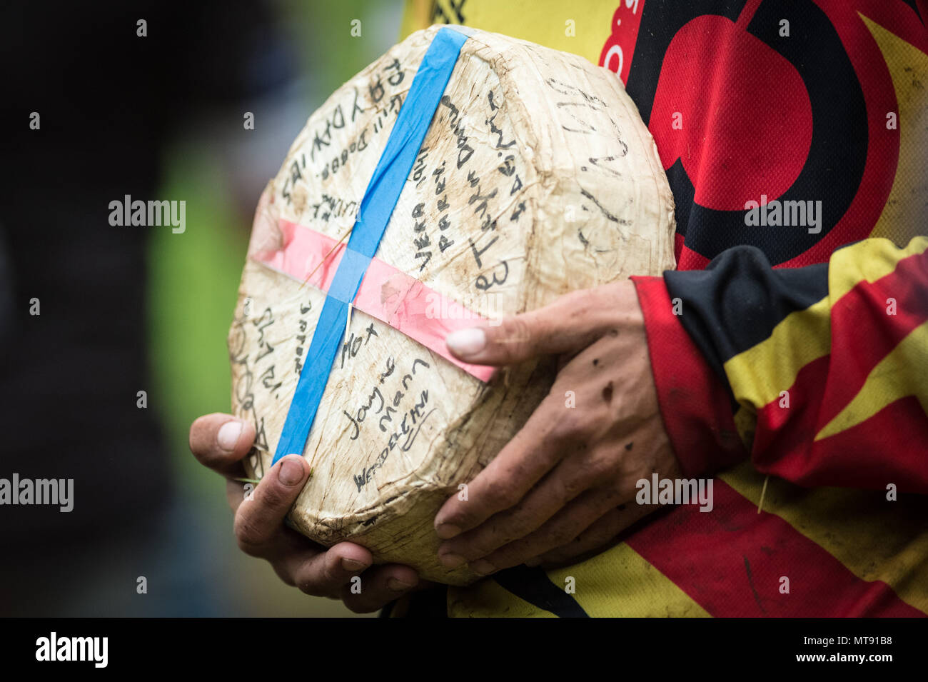 Gloucester, UK. 28th May 2018. Annual Cheese Roll on Coopers Hill. Dating back to 1800s, the annual Cheese-Rolling and Wake race involves fearless competitors chasing a 9lb (4.1KG) round of Double Gloucester cheese 200 meters down the 1:2 gradient hill. The cheese is allowed a one-second head start and can reach speeds up to 70mph. There are usually a number of injuries each year. Credit: Guy Corbishley/Alamy Live News - Stock Image